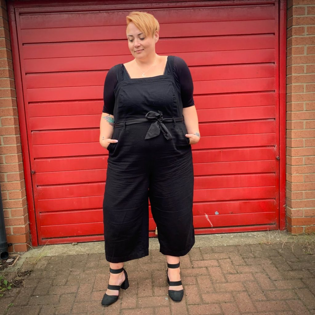 Plus Size woman in black outfit